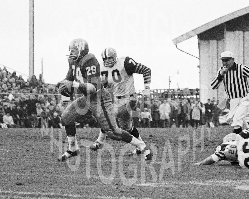 Leo Lewis Winnipeg Blue Bombers and Dave Viti Hamilton Tiger Cats 1965. Copyright photograph Scott Grant