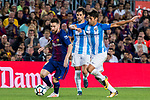 Lionel Andres Messi (l) of FC Barcelona is tackled by Rodrigo Emanuel Cecchini of Malaga CF during the La Liga 2017-18 match between FC Barcelona and Malaga CF at Camp Nou on 21 October 2017 in Barcelona, Spain. Photo by Vicens Gimenez / Power Sport Images