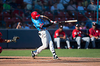 Spokane Indians third baseman Diosbel Arias (21) follows through on his swing during a Northwest League game against the Vancouver Canadians at Avista Stadium on September 2, 2018 in Spokane, Washington. The Spokane Indians defeated the Vancouver Canadians by a score of 3-1. (Zachary Lucy/Four Seam Images)