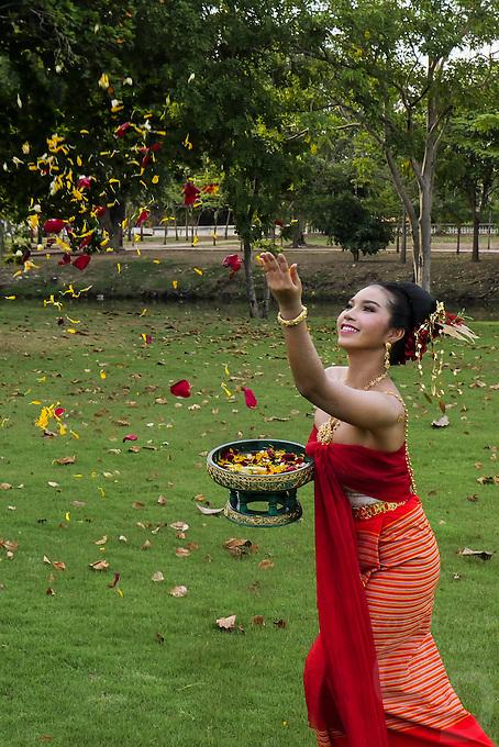 Traditional Thai Girl celebration with flowers, Phra Nakhon Si Ayutthaya, Thailand.