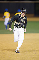 Gavin Sheets (24) of the Wake Forest Demon Deacons hustles towards third base on his way to scoring a run against the Delaware Blue Hens at Wake Forest Baseball Park on February 13, 2015 in Winston-Salem, North Carolina.  The Demon Deacons defeated the Blue Hens 3-2.  (Brian Westerholt/Four Seam Images)