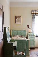 This single bedroom is furnished with matching painted pieces