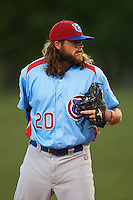Tennessee Smokies pitcher P.J. Francescon (20) looks in for the sign during a game against the Montgomery Biscuits on May 25, 2015 at Riverwalk Stadium in Montgomery, Alabama.  Tennessee defeated Montgomery 6-3 as the game was called after eight innings due to rain.  (Mike Janes/Four Seam Images)