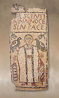 The Christian Eastern Roman Byzantine memorial funerary mosaic for Crescentia. <br /> Above the funerary portrait of Crescentia are the words: 'Crescentia, innocent and in Peace'. Crescentia is dressed in a dalmatic, a long wide-sleeved tunic, with a belt around the waiste and a neclace around her neck. Lit candles represent eternal life. 5th century AD from the western necropolis of Thabraca, Tabarka, Tunisia, Bardo Museum, Tunis, Tunisia