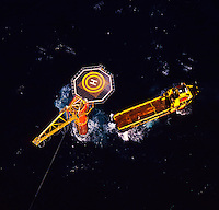 Offshore oil loading column, single point mooring, and work boat, North Sea. Aerial.