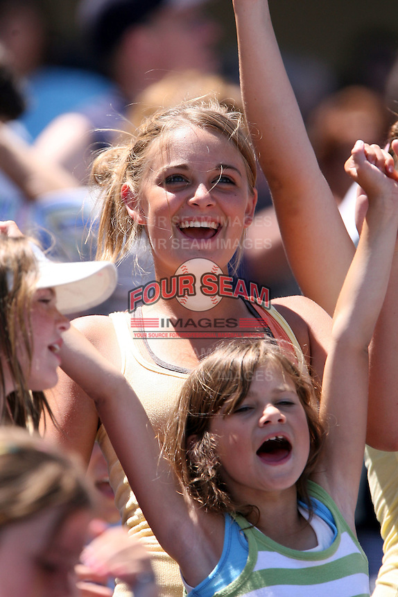 July 10th 2008:  Two female fans cheer on the Akron Aeros, Class-AA affiliate of the Cleveland Indians, during a game at Canal Park in Akron, OH.  Photo by:  Mike Janes/Four Seam Images
