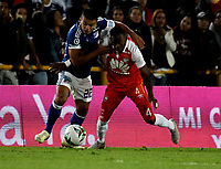 BOGOTÁ - COLOMBIA, 15-01-2019: Carlos Arboleda (Der.) jugador de Independiente Santa Fe disputa el balón con Jhon Duque (Izq.) jugador de Millonarios, durante partido entre Independiente Santa Fe y Millonarios, por el Torneo Fox Sports 2019, jugado en el estadio Nemesio Camacho El Campin de la ciudad de Bogotá. / Carlos Arboleda (R) player of Independiente Santa Fe vies for the ball with con Jhon Duque (L) player of Millonarios during a match between Independiente Santa Fe and Millonarios, for the Fox Sports Tournament 2019, played at the Nemesio Camacho El Campin stadium in the city of Bogota. Photo: VizzorImage / Luis Ramírez / Staff.