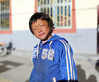A Tibetan nomad on the Tibetan Plateau, in western China. Up to 100,000 nomads have been removed from the highland grasslands of the Tibetan Plateau. Climate change, mining and government policy are causing the rapid disappearance of this unique culture.