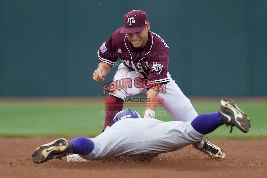 Texas A&M Aggies shortstop Mikey Reynolds (16) tags out LSU Tigers base runner Sean McMullen (7) at second base in the first inning of the NCAA Southeastern Conference baseball game on May 10, 2013 at Blue Bell Park in College Station, Texas. LSU defeated Texas A&M 7-4. (Andrew Woolley/Four Seam Images).