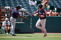Binghamton Rumble Ponies coach Ender Chavez congratulates Patrick Mazeika (19) after a home run during an Eastern League game against the Bowie Baysox on August 21, 2019 at Prince George's Stadium in Bowie, Maryland.  Bowie defeated Binghamton 7-6 in ten innings.  (Mike Janes/Four Seam Images)