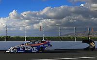 Nov. 9, 2012; Pomona, CA, USA: NHRA funny car driver Tony Pedregon during qualifying for the Auto Club Finals at at Auto Club Raceway at Pomona. Mandatory Credit: Mark J. Rebilas-
