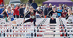 RAPID CITY, SD - MAY 30: Haley Bruggeman #76 of Harrisburg leads Elizabeth Schaefer #184 of Rapid City Stevens, Mearah Miedema #277 of Sioux Falls Washington and Mikkalyn Konzem #250 of Sioux Falls Roosevelt in the girls class AA 100 meter hurdles during the 2015 SDHSAA State Track & Field Meet Saturday at O'Harra Stadium in Rapid City, S.D. (Photo by Dick Carlson/Inertia)