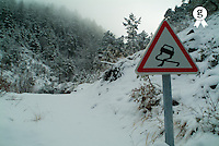 Slippery warning road sign by a cloudy cold weather, Chabanon, France (Licence this image exclusively with Getty: http://www.gettyimages.com/detail/82406727 )