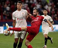 14th September 2021; Sevilla, Spain: UEFA Champions League football, Sevilla FC versus RB Salzburg; Andreas Ulmer of Salzburg clears from Erik Lamela of Sevilla