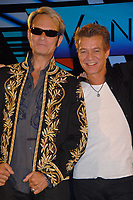 06 October 2020 - Eddie Van Halen, legendary Hall of Fame Guitarist and co-founder of Van Halen -- has died after a long battle with throat cancer at the age of 65. File Photo: 13 August 2007 - Beverly Hills, California - David Lee Roth and Eddie Van Halen. Van Halen and David Lee Roth Announce North American Tour at the Four Seasons Hotel. Photo Credit: Byron Purvis/AdMedia