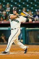 Josh Ludy #30 of the Baylor Bears follows through on his swing against the Utah Utes at Minute Maid Park on March 5, 2011 in Houston, Texas.  Photo by Brian Westerholt / Four Seam Images