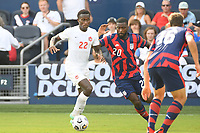 KANSAS CITY, KS - JULY 18: Richie Laryea #22 of Canada ,Shaq Moore #20 of the United States during a game between Canada and USMNT at Children's Mercy Park on July 18, 2021 in Kansas City, Kansas.