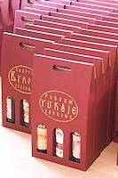 Gift boxes containing three bottles of wine lined up,, in the winery tasting room. Vukoje winery, Trebinje. Republika Srpska. Bosnia Herzegovina, Europe.
