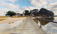 BNPS.co.uk (01202 558833)<br /> Pic: Albury&Hall/BNPS<br /> <br /> A long pier gives access whatever the tides.<br /> <br /> Love Islands ? - Then this idyllic spot in the middle of Poole harbour in Dorset could be the perfect escape.<br /> <br /> 15 acre Round island has been put up for long term rent by its owners for £15,000 a month.<br /> <br /> For that the lucky tenants will get the use of three cottages with space for up to 20 people as well the services of two caretakers who live in another property on the island. <br /> <br /> They provide boat 15 minute boat rides to the mainland at the request of the tenants.<br /> <br /> The nearest shops, restaurants and amenities are three miles away in Poole and the exclusive resort of Sandbanks.