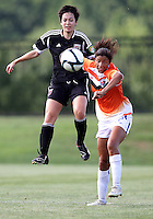 BOYDS, MARYLAND - July 22, 2012:  Diane Weigel (15) of DC United Women jumps at Rachel Baer (2) of the Charlotte Lady Eagles during the W League Eastern Conference Championship match at Maryland Soccerplex, in Boyds, Maryland on July 22. DC United Women won 3-0.