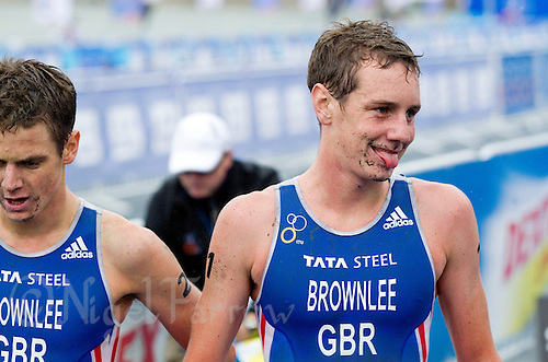 10 SEP 2011 - BEIJING, CHN - Alistair Brownlee (GBR) recovers after winning the 2011 Elite Mens ITU World Championship Series Grand Final Triathlon (PHOTO (C) NIGEL FARROW)