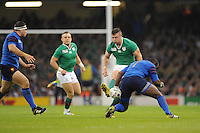 Robbie Henshaw of Ireland chips past Eddy Ben Arous of France during Match 39 of the Rugby World Cup 2015 between France and Ireland - 11/10/2015 - Millennium Stadium, Cardiff<br /> Mandatory Credit: Rob Munro/Stewart Communications