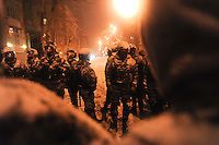 Police force opposing the protesters in the streets of government district of Kiev.  Tonight the  police is expected to forcedly evacuate the streets from the protesters blocking all the government buildings. Kiev. Ukraine.