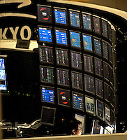 A trader at the Tokyo Stock Exchange.  Stocks in Tokyo have plummeted in recent months as Japan's economy has taken a pounding  as industrial production in Japan plunged at the steepest pace in 55 years in the fourth quarter, and unemployment rose at the fastest rate in 41 years with exports in the third quarter were a record 13.9 per cent lower than in the previous quarter.