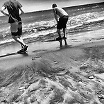 Walking along the sands of this beach, these two teenagers become children again. Water seems to return us to our source - on many different levels.