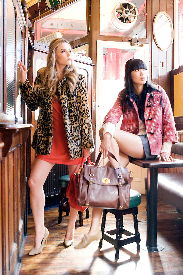 NO REPRO FEE.30/8/2010. AWEAR AUTUMN COLLECTION. Yomiko Chen & Sarah Morrissey model a selection of dresses from A wear's new autumn '10 collection at Kehoes Pub in Dublin. Sarah wears Leopard Print Swing Coat - EUR70 Tamarind Bow Shift Dress - EUR45 - EUR35 .Yomiko Chen wears Red woven duffle coat - EUR60 Side tie shorts - EUR30 Aran knit jumper - EUR35  The collection arrives instore and onwww.awear.comfrom this week. Picture James Horan/Collins Photos