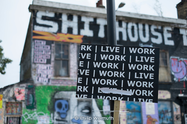 Gentrification in east London. Ad for combined live and work spaces in Hackney Wick, a rundown area of warehouses, small industrial units and tenement blocks next to the Olympic Park.