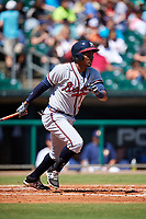 Mississippi Braves third baseman Carlos Franco (13) follows through on a swing during a game against the Montgomery Biscuits on April 25, 2017 at Montgomery Riverwalk Stadium in Montgomery, Alabama.  Mississippi defeated Montgomery 3-2.  (Mike Janes/Four Seam Images)