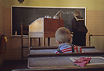 Boy at a desk in an old schoolhouse at the Oxford County Fairgrounds, Fryeburg, Maine, USA