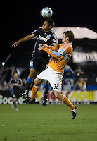 Quincy Amarikwa (left) goes up for the header against Bobby Boswell (32). San Jose Earthquakes defeated Houston Dynamo 3-2 at Buck Shaw Stadium in Santa Clara, California on March 28th, 2009.