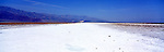 America Panorama - Salt Flats at Badwater Basin. Death Valley, California, America.<br /> <br /> Image taken on large format panoramic 6cm x 17cm transparency.  Available for licencing and printing. email us at contact@widescenes.com for pricing. <br /> <br /> WARNING: Image Protected with PIXSY