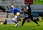 St Johnstone v Livingston…12.12.20   McDiarmid Park      SPFL<br />David Wotherspoon knocks the ball past Marvin Bartley<br />Picture by Graeme Hart.<br />Copyright Perthshire Picture Agency<br />Tel: 01738 623350  Mobile: 07990 594431