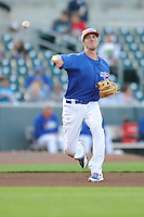 Kris Bryant #19 of the Iowa Cubs throws to first base against the Omaha Storm Chasers at Principal Park on July 2, 2014 in Des Moines, Iowa. The Cubs  beat Storm Chasers 4-3.   (Dennis Hubbard/Four Seam Images)