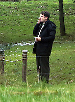 Elijah Wood has a hot drink and cigarette between takes<br />