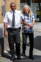 COPY BY TOM BEDFORD <br /> Pictured: Russell Isaac leaving Swansea Magistrates Court. Monday 19 August 2019<br /> Re: Russell Isaac has been jailed for four months at Swansea Magistrates Court, after he was caught claiming benefits while working in a Fleetwood Mac tribute band.