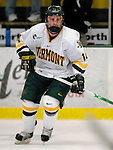 """5 January 2007: University of Vermont forward Brian Roloff (14) from West Seneca, NY, in action against the University of New Hampshire Wildcats at Gutterson Fieldhouse in Burlington, Vermont. The UNH Wildcats defeated the UVM Catamounts 7-1 in front of a record setting 48th consecutive sellout at """"the Gut""""...Mandatory Photo Credit: Ed Wolfstein Photo.<br />"""