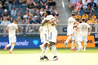 KANSAS CITY, KS - JUNE 26: Los Angeles FC players celebrate their opening goal during a game between Los Angeles FC and Sporting Kansas City at Children's Mercy Park on June 26, 2021 in Kansas City, Kansas.