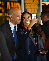 """LOS ANGELES, USA. October 11, 2019: Senator Cory Booker & Rosario Dawson at the premiere of """"Zombieland: Double Tap"""" at the Regency Village Theatre.<br /> Picture: Paul Smith/Featureflash"""
