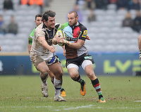 20130309 Copyright onEdition 2013©.Free for editorial use image, please credit: onEdition..Ross Chisholm of Harlequins is tackled by Nathan Catt of Bath Rugby during the LV= Cup semi final match between Harlequins and Bath Rugby at The Twickenham Stoop on Saturday 9th March 2013 (Photo by Rob Munro)..For press contacts contact: Sam Feasey at brandRapport on M: +44 (0)7717 757114 E: SFeasey@brand-rapport.com..If you require a higher resolution image or you have any other onEdition photographic enquiries, please contact onEdition on 0845 900 2 900 or email info@onEdition.com.This image is copyright onEdition 2013©..This image has been supplied by onEdition and must be credited onEdition. The author is asserting his full Moral rights in relation to the publication of this image. Rights for onward transmission of any image or file is not granted or implied. Changing or deleting Copyright information is illegal as specified in the Copyright, Design and Patents Act 1988. If you are in any way unsure of your right to publish this image please contact onEdition on 0845 900 2 900 or email info@onEdition.com