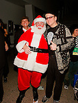 Santa Claus and Rick Nielsen of Cheap Trick at Alice Cooper's Christmas Pudding show for his Solid Rock Foundation Charity at Dodge Theatre in Phoenix, Arizona, December 18th 2004. Photo by Chris Walter/Photofeatures.