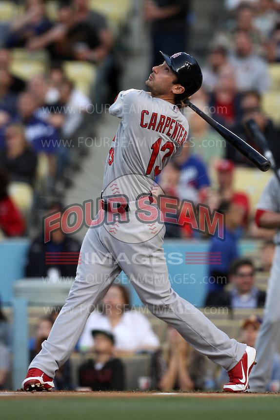 Matt Carpenter #13 of the St.Louis Cardinals bats against the Los Angeles Dodgers at Dodger Stadium on May 18, 2012 in Los Angeles,California. Los Angeles defeated St.Louis 6-5.(Larry Goren/Four Seam Images)