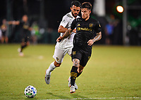 LAKE BUENA VISTA, FL - JULY 18: Brian Rodríguez #17 of LAFC runs onto a pass while pursued by Giancarlo González #21 of LA Galaxy during a game between Los Angeles Galaxy and Los Angeles FC at ESPN Wide World of Sports on July 18, 2020 in Lake Buena Vista, Florida.