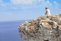 "Girl sitting on a rock of Devia hill and observing Volga reservoir in Russian National Park ""Samarskaya Luka"""