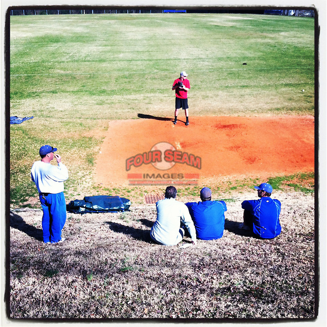 Coaches watch former Spartanburg Methodist College pitcher Heath Hembree throw a bullpen session before heading to Spring Training with the San Francisco Giants. (Tom Priddy/Four Seam Images)