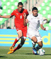 .Action photo oF Michael Luftner of the Czech Republic (L) and Mario Rodriguez of USA (R), during game of the FIFA Under 17 World Cup game, held at  Torreon.