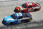 BRISTOL, TENNESSEE - MAY 31: Martin Truex Jr., driver of the #19 Auto Owners Insurance Toyota, races Kyle Busch, driver of the #18 Skittles Toyota, during the NASCAR Cup Series Food City presents the Supermarket Heroes 500 at Bristol Motor Speedway on May 31, 2020 in Bristol, Tennessee. (Photo by Jared C. Tilton/Getty Images)